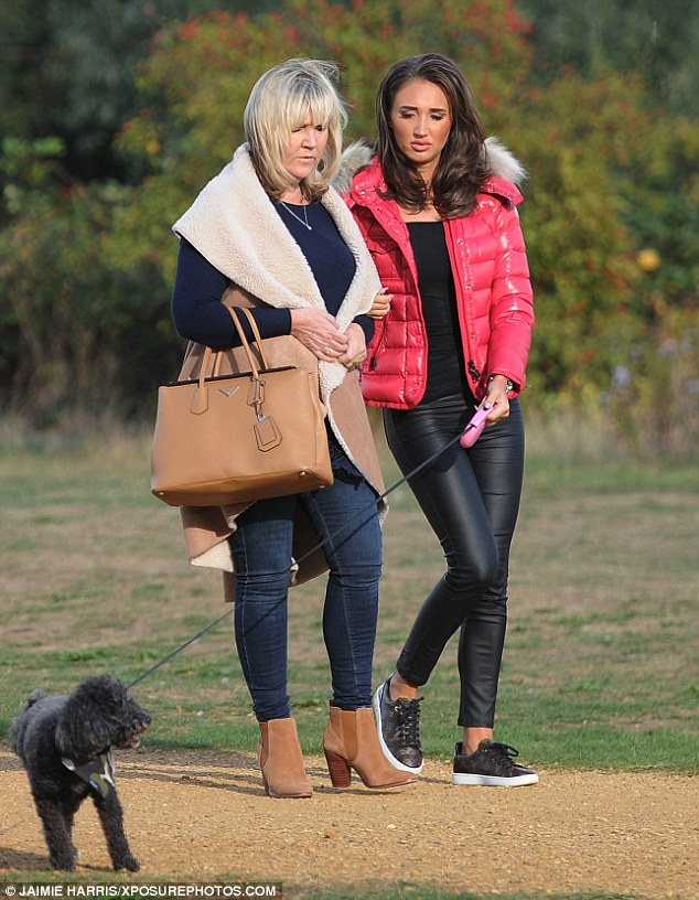 Mamma mia! Strolling through the local green space, she was arm-in-arm with her blonde matriarch, who looked more stylish than her daughter