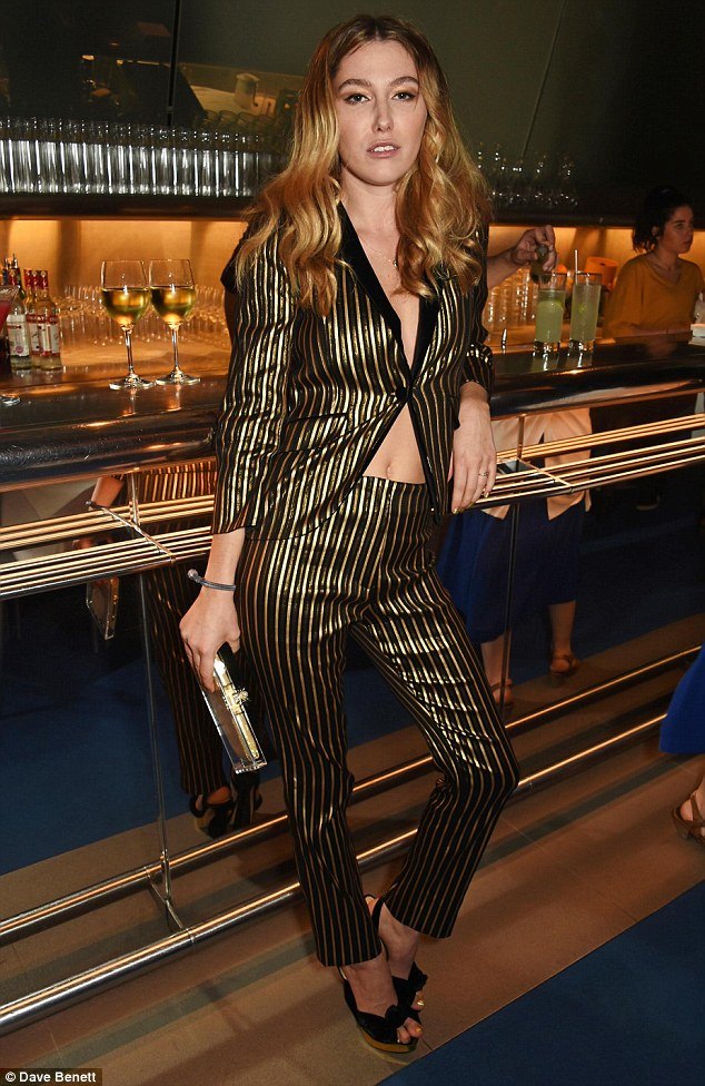 Fierce: Daisy stole the show as the bride-to-be in a striking black and gold suit