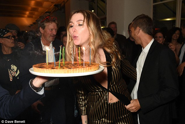 Breaking tradition: The star was not only unconventional with her style but party choices too, blowing the candles of a custard tart rather than a cake