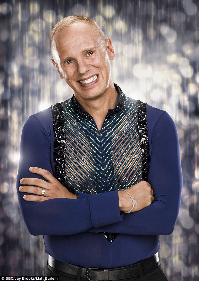 Sparkle: Judge Rinder is usually seen sporting much more camp attire for the dance contest