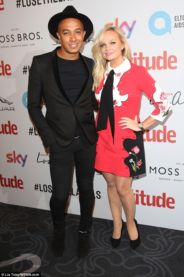 The happy couple: Emma Bunton went for a demure tea dress in a fuchsia and white pattern with a Peter Pan collar while she was joined by her trendy beau Jade Jones
