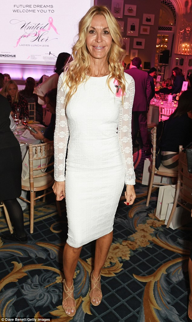Bright white:Swimwear designer Melissa Odabash attended, looking radiant in a white knee-length dress with long lace sleeves