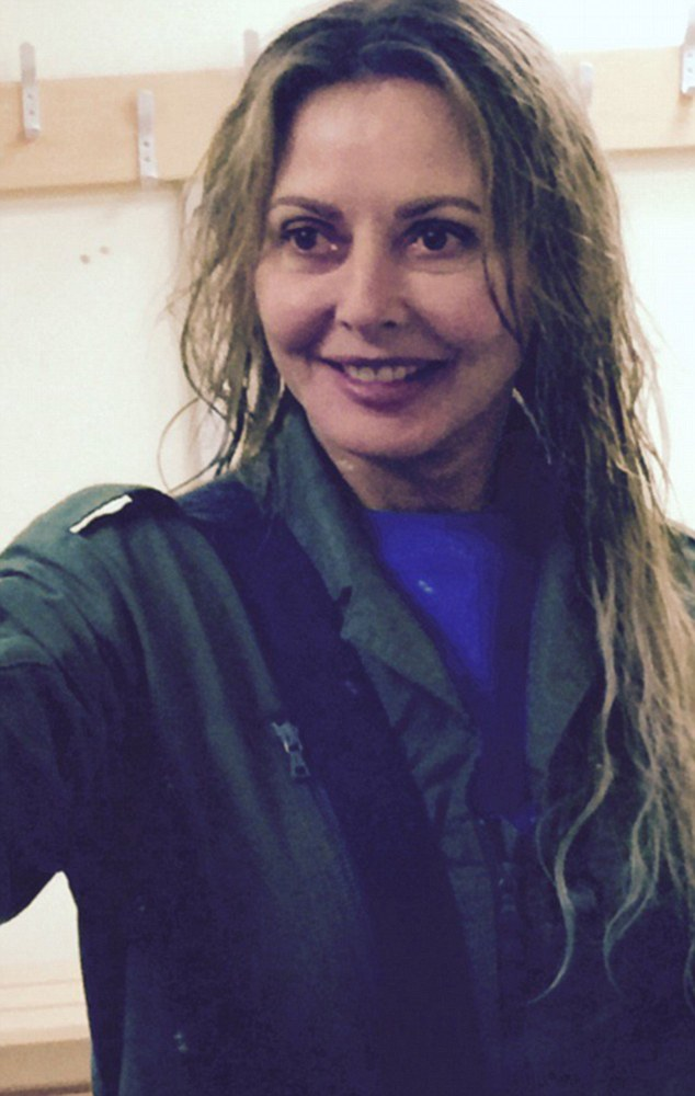 In too deep: Carol Vorderman is determined to prepare for all eventualities as she sets off on her solo round the world plane trip, as proved when she plunged into the murky depths of the ocean in Fowey, Cornwall on Saturday