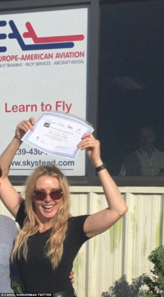 Woo! In a snap shared on Twitter, she grinned from ear to ear and added: 'Happy bird......multi engine flying exam passed...woohoo x