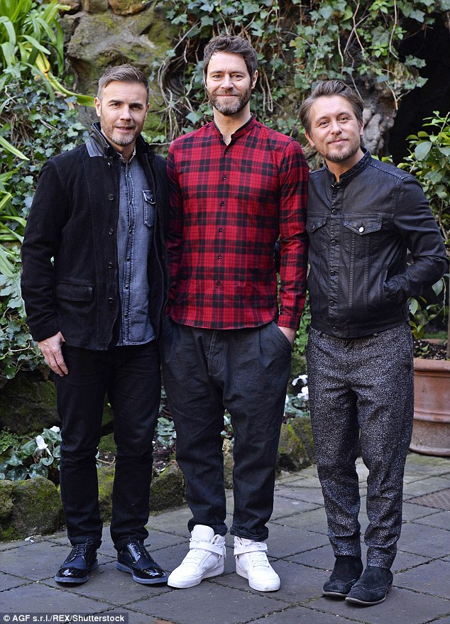 Famous face: Howard (centre) has been with Take That bandmates Gary Barlow and Mark Owen (here in February) for over 20 years