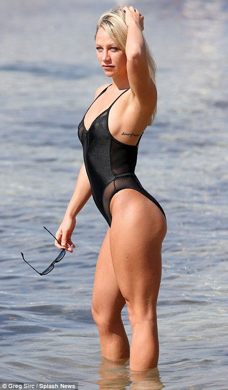 Fitness model Chloe Madeley shows off her phenomenal figure in racy swimsuit in Ibiza