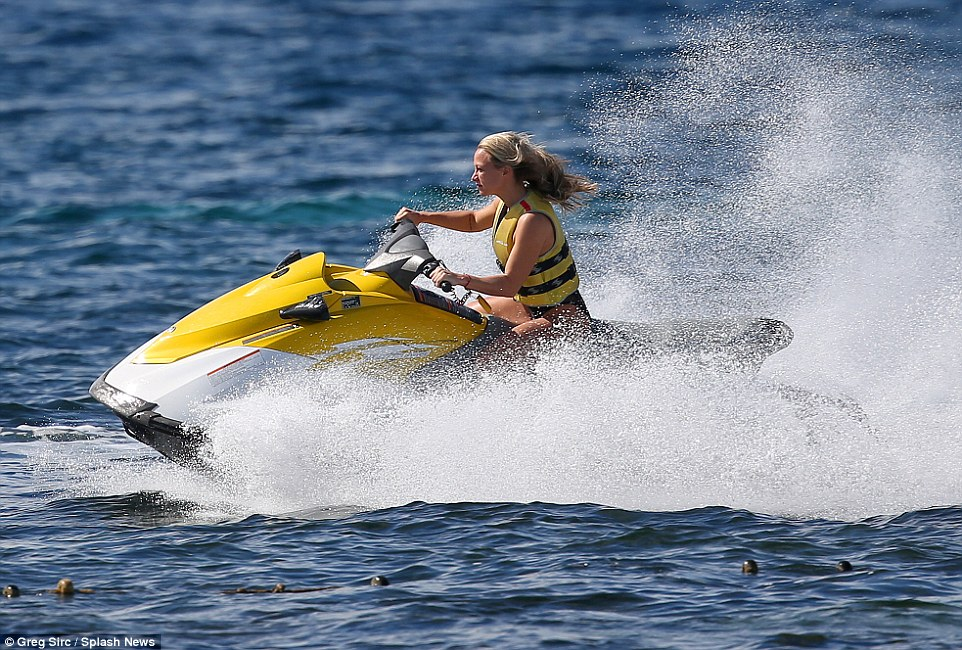Zoom zoom: The water whipped up around Chloe as she raced around in her jetski, with her hair flowing in the wind