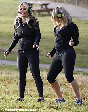 Having a ball! The two gal pals could not stop laughing together as they got their groove on in a park in Essex