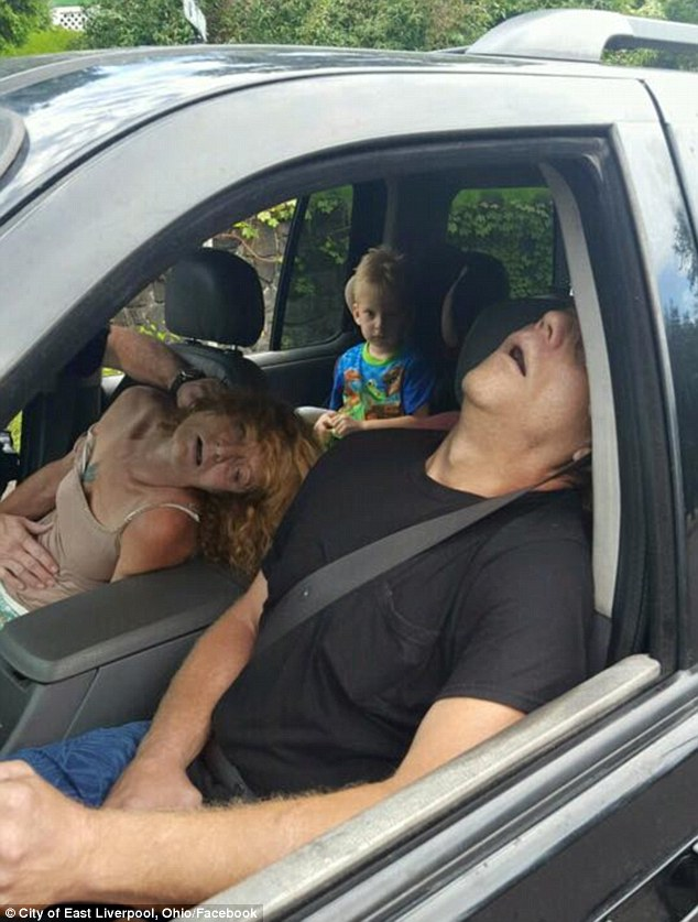 'This horrible drug': Ohio police shared this distressing photograph on social media. It shows Rhonda Pasek and her boyfriend James Acord passed out in their vehicle while Pasek's four-year-old grandson looks on from the back seat. Both were jailed after pleading guilty to charges of child endangering