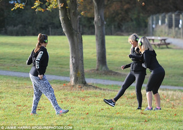 Having a blast:The friends couldn't contain their laughter during their workout as they attempted to copy their instructor in the park