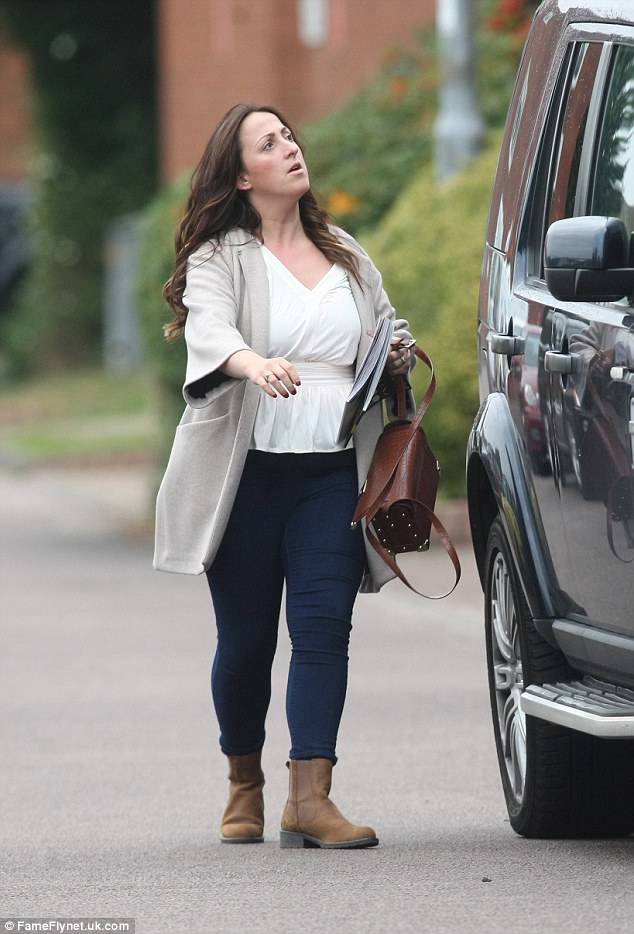 Errands: The 33-year-old former Eastender star put on a casual display as she stocked up on goods for her family, which now includes little Joanie Elizabeth