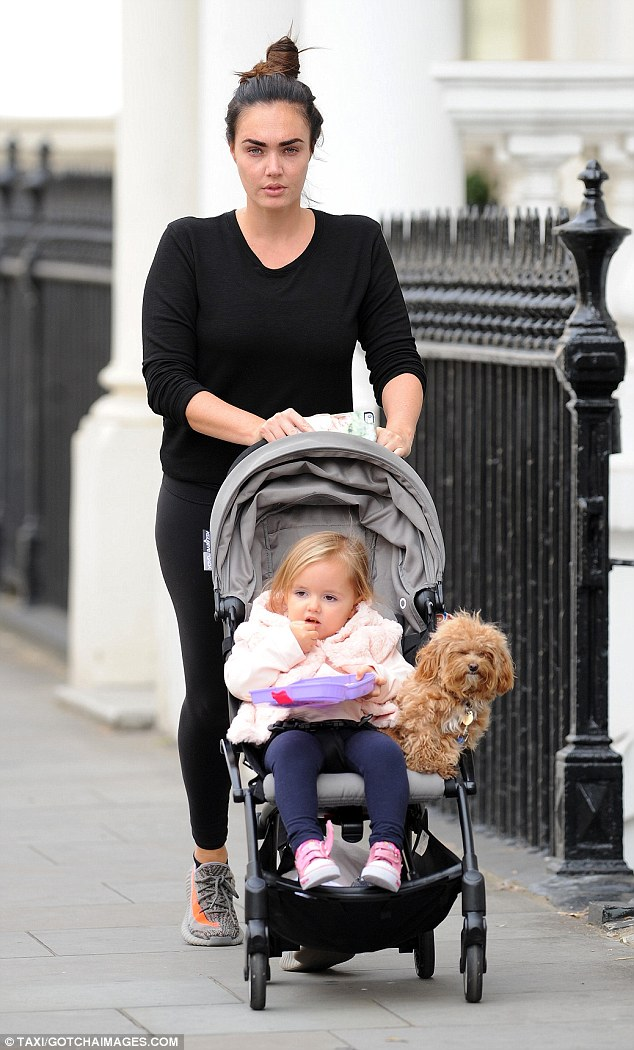 Yummy mummy: Tamara Ecclestone continued to be the doting mother as she stepped out with her cute tot and adorable pet pooch in London on Sunday