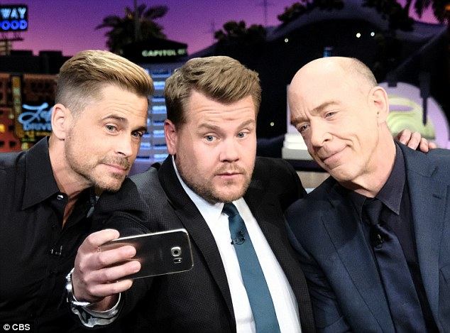 Success story: James took over as host of the Late Late Show last March and has found huge success in the role - mixing with Hollywood celebs such as Rob Lowe (L) and JK Simmons (R)
