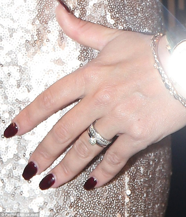 Something to tell us? Taking centre stage was her new sparkler, which sat alongside her engagement-style ring