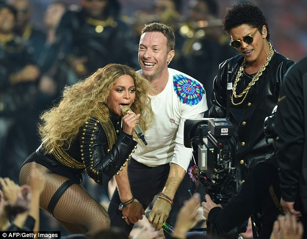 He is on the list: Bruno Mars, seen here with Beyonce and Chris Martin in February, is also set to perform