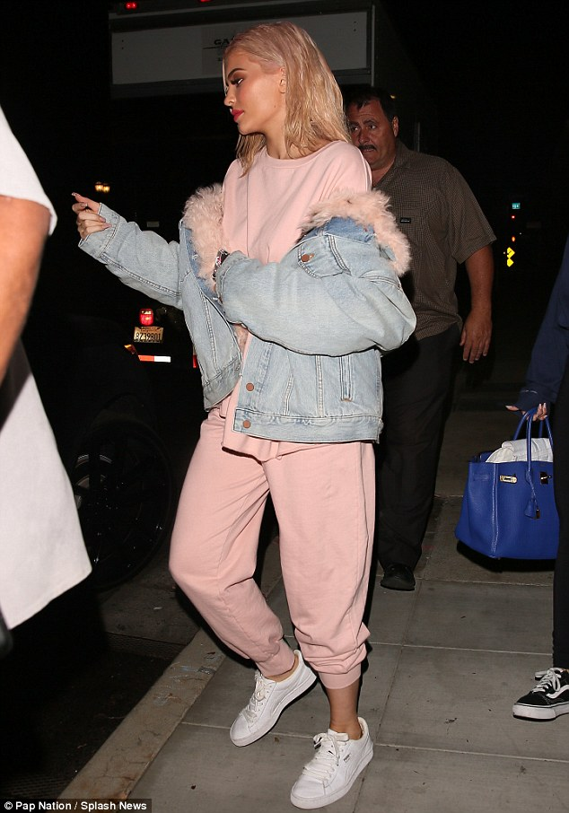 Feeling herself: The star, who opened up about getting lips injections, was seen with a bright pout on Monday evening while out in Los Angeles
