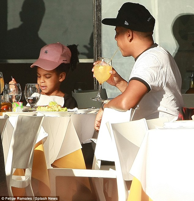 Bonding time: The pair enjoyed an al fresco meal at a restaurant overlooking the Hudson river