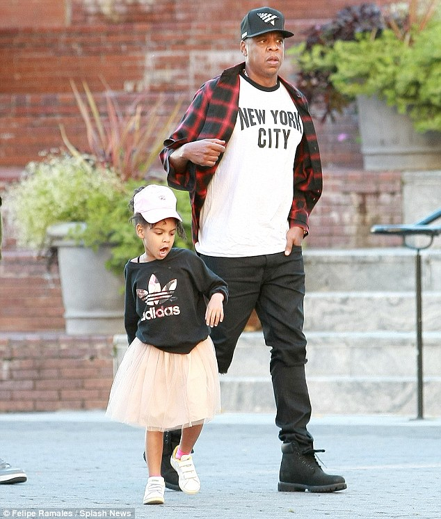 Hat's cute: The pair both wore baseball caps, and Blue also sported a tutu skirt and Adidas jumper