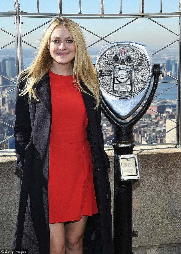 Pretty: The 22-year-old actress dazzled in red as she lit up the Empire State building in NYC in honour of the day designed to focus on empowering young women