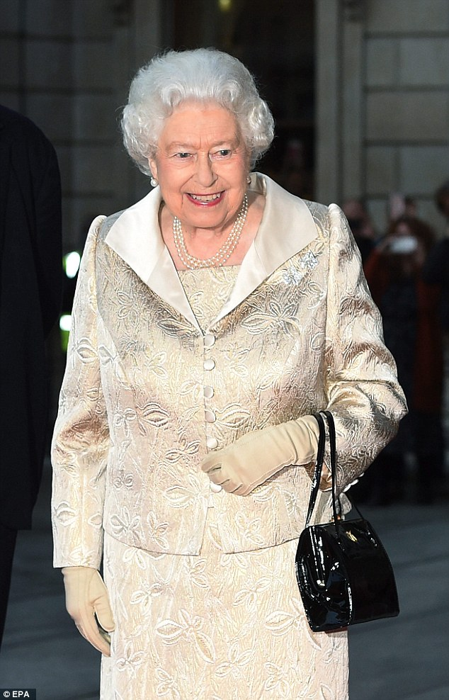 A beaming queen:As they headed into the event ahead of Queen Elizabeth, she was hot on their trail looking in high spirits while sporting an exquisite jacquard two-piece cream suit