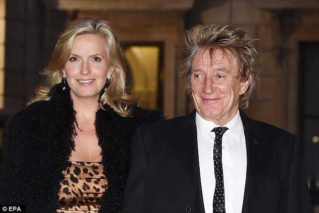 A glam pair: The 71-year-old rocker shed the tartan trousers he wore earlier in the day at Buckingham Palace as he sported a slick black suit while Penny, 45, got racy in a leopard print mini dress and fur stole