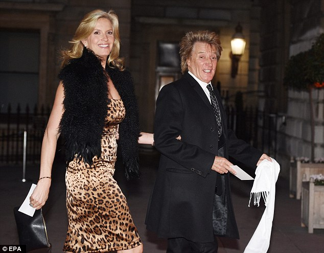 Dashing:While Rod looked slick in a black suit, Penny slipped into a super sexy leopard print gown paired with a stunning black fur stole, while boosting her height with a pair of staggering heels