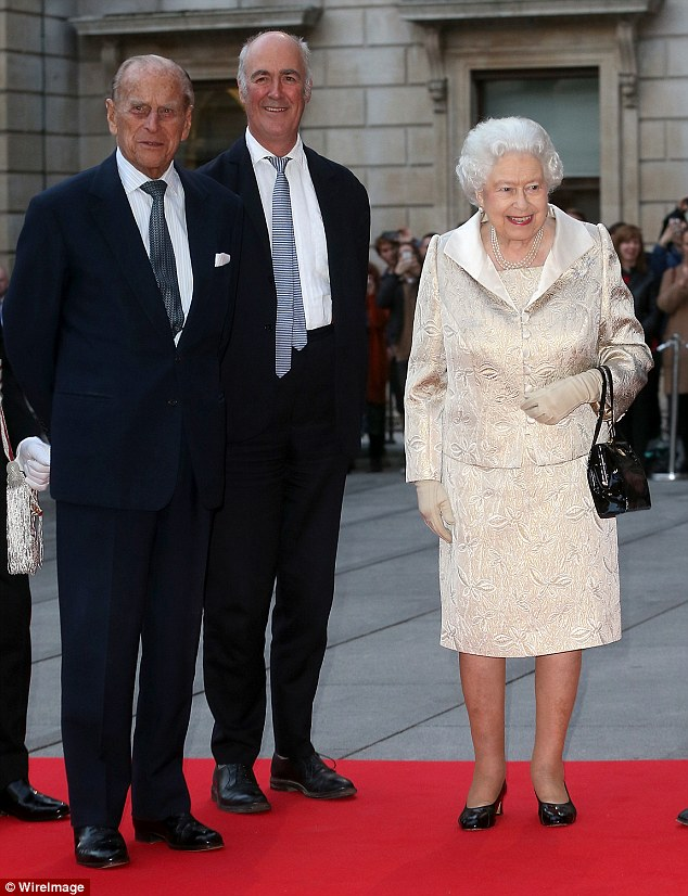 Smiles all around:The beaming monarch looked overjoyed to be attending the ceremony as she greeted waiting guests with a warm handshake followed by her husband