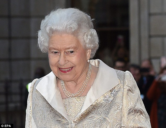 Smiley as ever: Paired with the ensemble was her favoured underarm handbag in a patent black leather alongside matching heels. She also wore elegant beige gloves