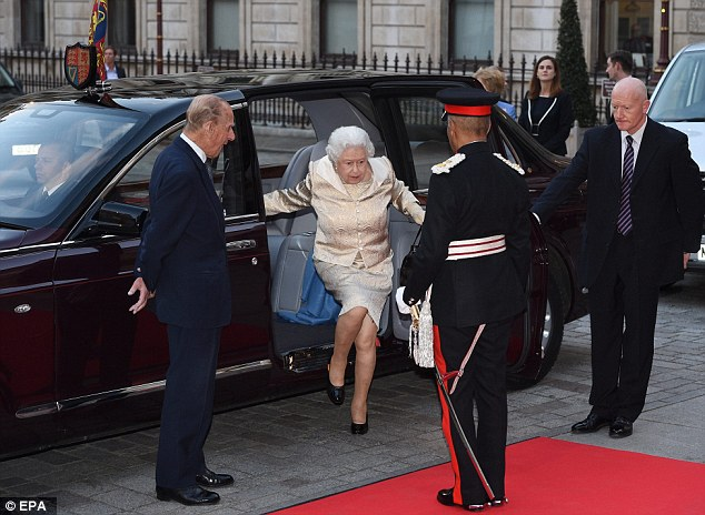 Arrival of the day: Queen Elizabeth was surrounded by her aides and her husband ahead of the ceremony