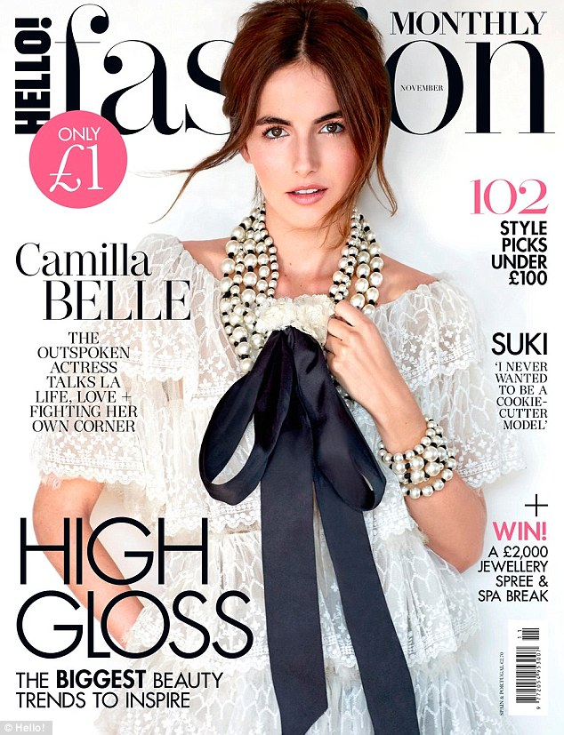 Front page news: The actress looked stunning in a white lace dress for the front cover of Hello! Fashion's November issue