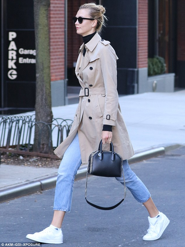 Keeping it simple: Karlie also wore capri jeans, a black turtleneck and white trainers