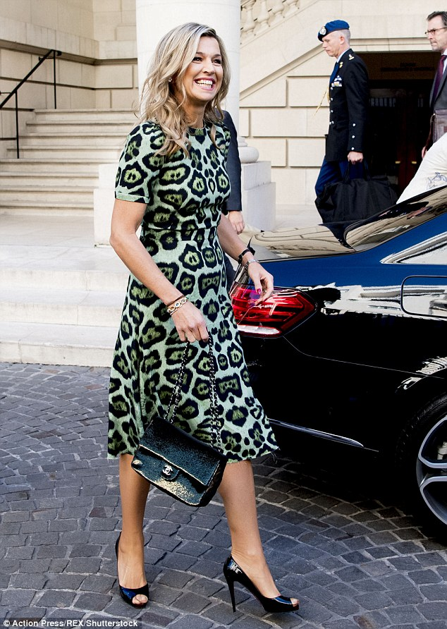 The stylish royal looked in her element in the Argentinian capital - which is also her birthplace -in the green leopard print number which she paired with peeptoe heels and a patent bag