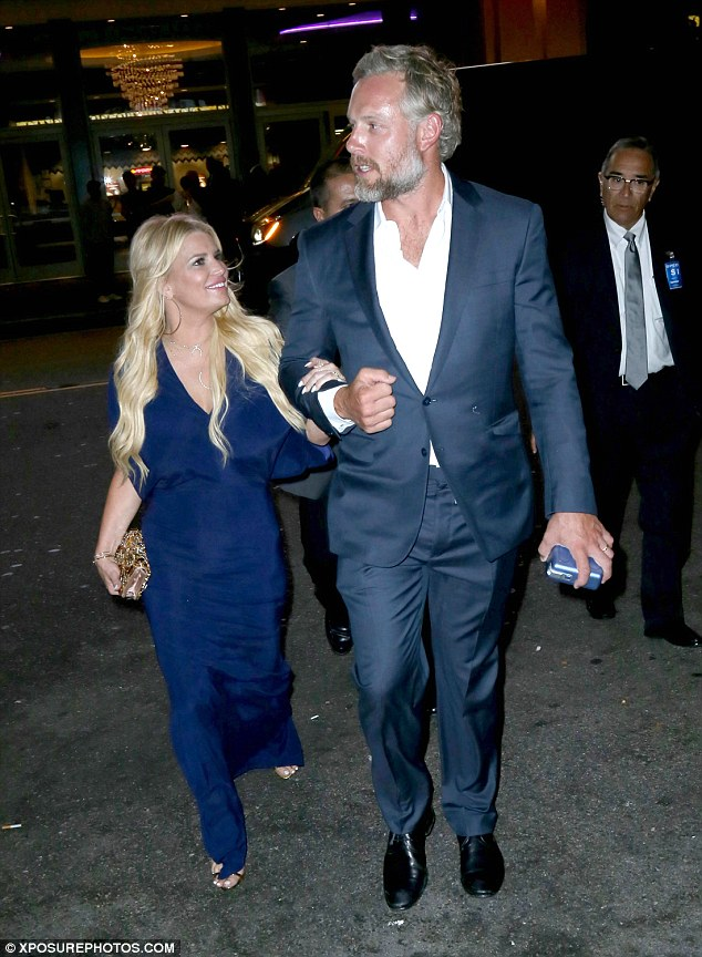 Dapper duo: Simpson looked very much in love with her spouse as they left a movie premiere in Los Angeles this past July
