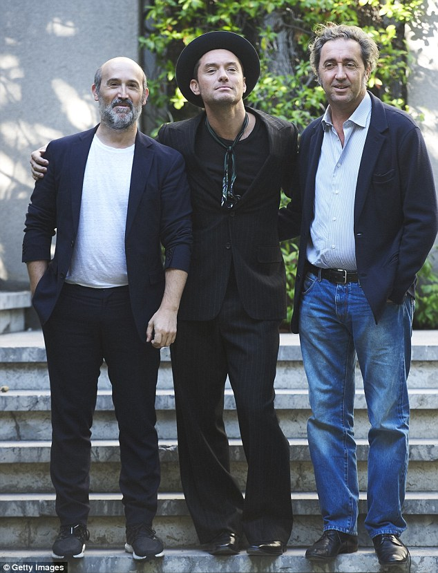 Squad: He posed to snapshots with (l-r) co-star Javier Camara and director Paolo Sorrentino