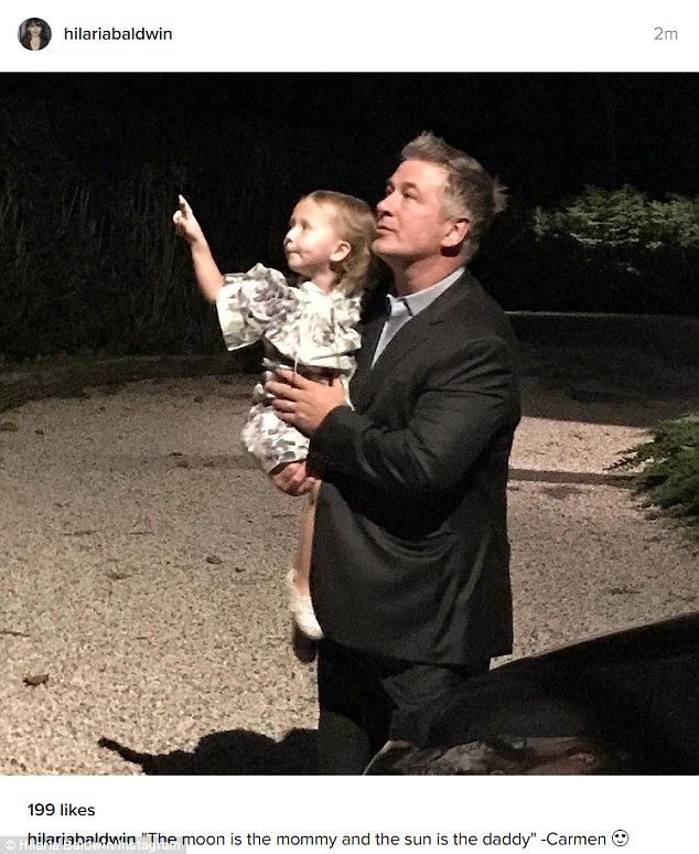 Capturing the moment! The yoga enthusiast posted this sweet snap of Alec and their eldest child Carmen, three, stargazing