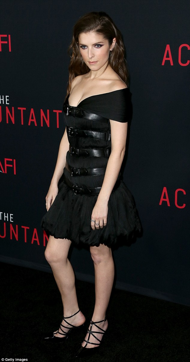 Gorgeous: Anna Kendrick wore a sexy black dress with leather straps to the premiere of her thriller The Accountant at TLC Theater in Hollywood on Monday