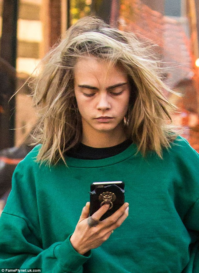 Bedhead!Cara Delevingne looked far from the smouldering temptress seen on billboards and in magazines as she stepped out in New York for a low-key jaunt to the shops on Monday