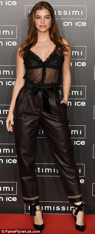 It's no wonder she caught his eye: Barbara looked stunning at the event in a sheer top and polka dot trousers