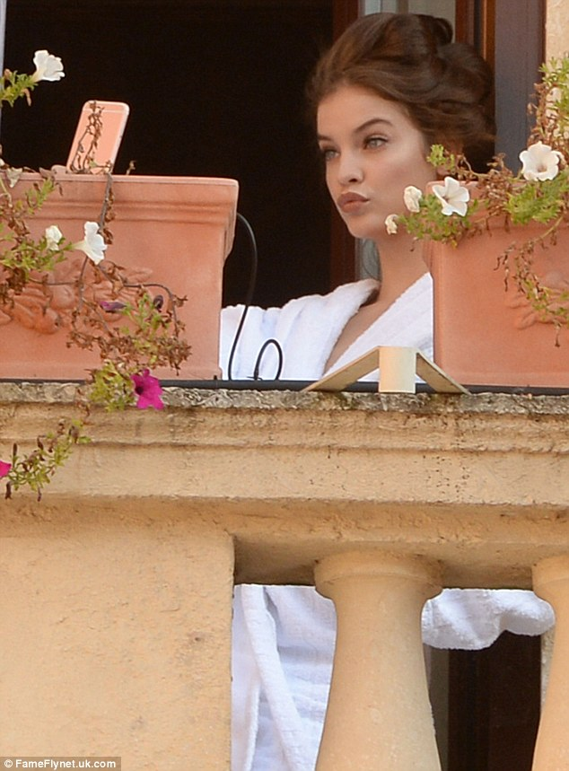 Say cheese: Earlier in the day, the model had been spotted snapping selfies on her hotel balcony while wearing just a robe