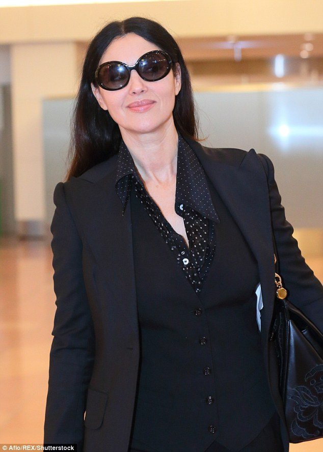 Chic: The Italian star skimmed her sensational curves with a fitted blazer over a polka dot blouse and waistcoat