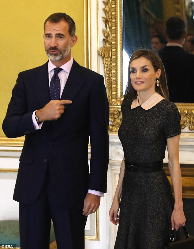 King Felipe, 48, larked around and showed who was really boss as he pointed at his wife in a jokey manner as they posed for snaps at an event in Madrid
