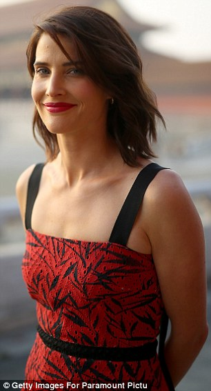 Beauty: She sported a bold red lip, as well as a hefty dose of blusher