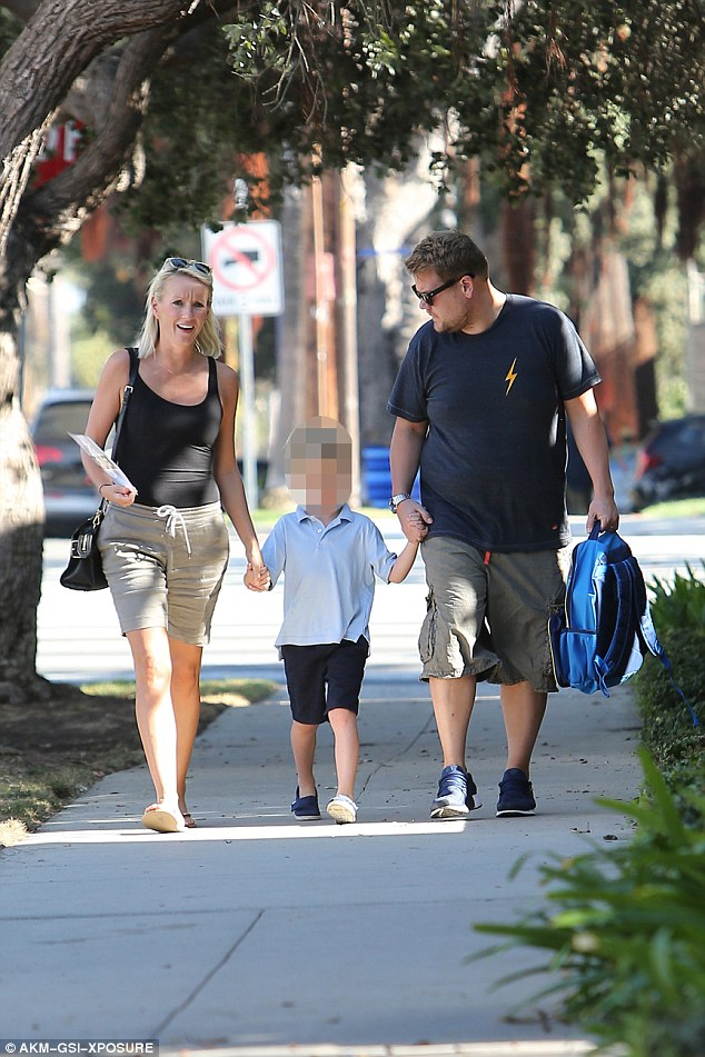 Feet on the ground: James Corden, 38, has remained a humble family man despite his stardom, with the Late Late Show host spotted enjoying a family stroll with son Max, seven, and wife Julia on Monday
