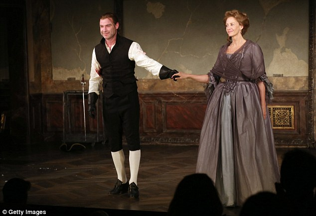 Period costume: He completed the look with a fitted waistcoat and bulky leather gloves as he performed alongside Janet McTeer