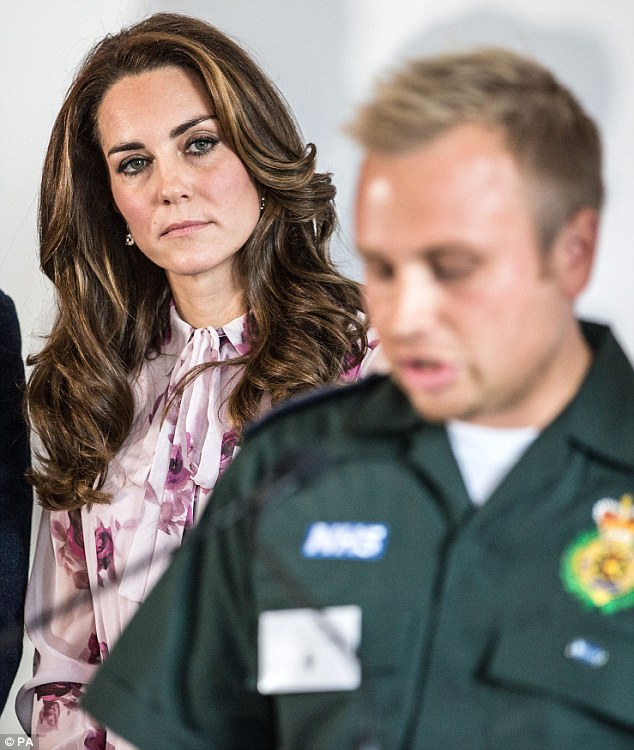 The Duchess of Cambridge listens to ambulance man Dan Farnworth speak of his mental ordeal following witnessing a traumatic situation during a reception at County Hall for World Mental Health Day