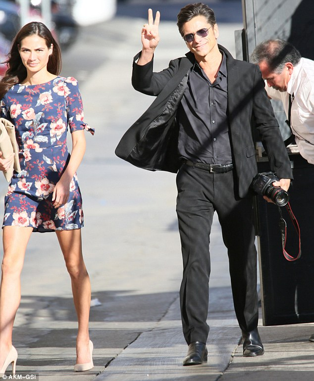 Staying close: The 53-year-old actor, who stars on Scream Queens, arrived with his girlfriend Caitlin McHugh