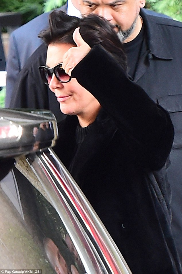Support: Kris was spotted the day after the attack and flashed a quick thumbs up as she exited Kim and Kanye's house