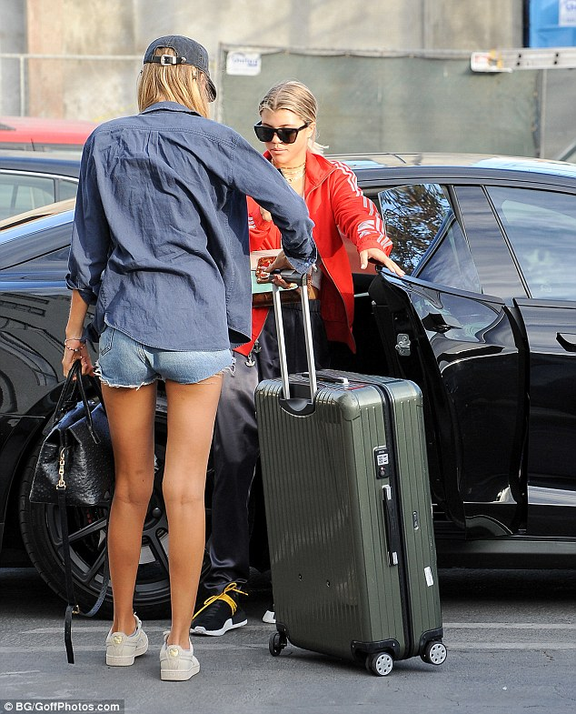 Extra baggage: Sofia and Bronte were weighed with luggage down as they climbed into their car
