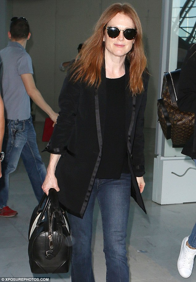 Julianne Moore always jets off with a mini hair iron in her carry-on to smooth out any kinks