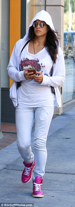 Stylish: The Texas native completed the look with matching white ensembles including a logo clad top and skinny jeans.